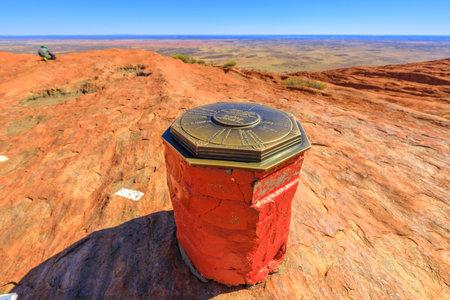 Uluru, Northern Territory, Australia - Aug 23, 2019: a cairn on top of the sacred site of Uluru-Kata Tjuta National Park at the end of trekking of Uluru climb. Editorial