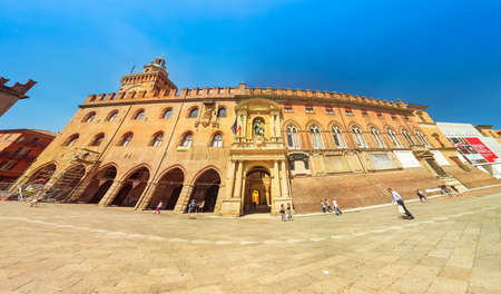 Bologna, Italy - June 24, 2019: panorama of clock tower and Palazzo d'Accursio or Comunale palace, overlooking Piazza Maggiore square, today the seat of the municipality of Bologna in Italy. Editorial