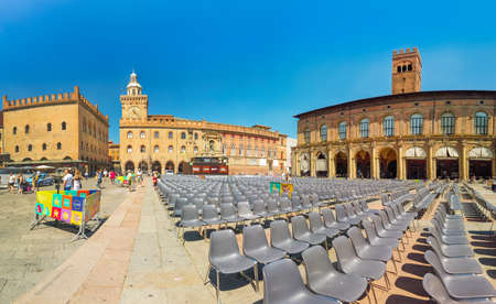 Bologna, Italy - June 24, 2019: panorama of Re Enzo palace, historical landmark palace and heart of economic and social activities of the city with many people and main square called Piazza Maggiore.