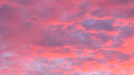 zoom in on red urban sunset with copy space. Sunset cloudscape background.