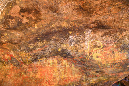 Uluru, Northern Territory, Australia - Aug 24, 2019: Aboriginal rock art in Mutitjulu Cave or Kulpi Mutitjulu, Anangu families caves, along Kuniya walk in Uluru-Kata Tjuta National Park.