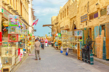 Doha, Qatar - February 19, 2019: pet shop and cages along pedestrian street inside Bird Souq, the old animal market and popular tourist attraction in Doha center, Middle East, Arabian Peninsula.
