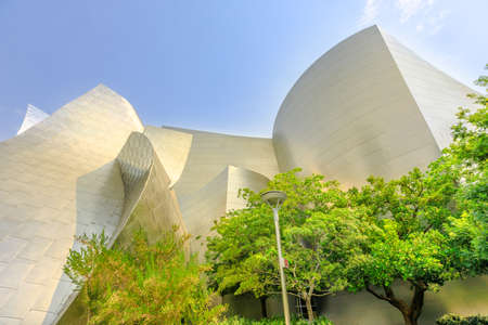 Los Angeles, California, United States - August 9, 2018: iconic architecture of Walt Disney Concert Hall designed by Frank Gehry on Grand Avenue, Bunker Hill, Downtown of LA. Sunny blue sky.