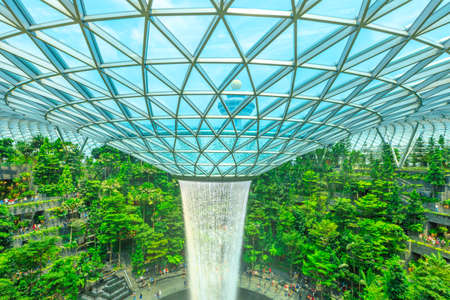 Singapore - Aug 8, 2019: details of Rain Vortex and glassed dome, the worlds largest indoor waterfall surrounded by a four-story terraced forest in Jewel Changi Airport opened on April 2019. Editorial