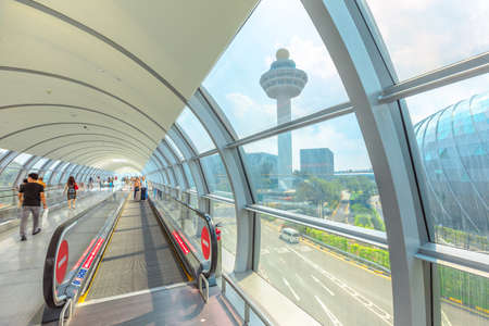 Singapore - Aug 8, 2019: view of Jewel glassed Dome and Control Tower from moving sidewalk inside Jewel Changi International Airport terminal 3 opened in April 2019. Editorial
