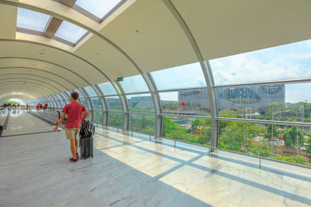 Singapore - Aug 8, 2019: Crowne Plaza hotel view from the corridor of Jewel Changi International Airport terminal 3 opened in April 2019. People traveling to the terminal for departure. Editorial