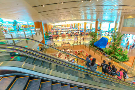 Singapore - Aug 8, 2019: interior lobby and escalator of new Jewel Changi International Airport opened in April 2019. People traveling to the terminal for departure. Editorial