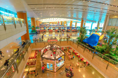 Singapore - Aug 8, 2019: aerial view of interior main lobby with passenger of new Jewel Changi International Airport opened in April 2019. People waiting her flight for departure.