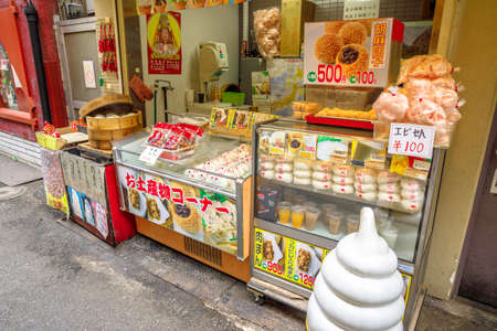 Yokohama, Japan - April 21, 2017: chinese food vendors on the road in Yokohama Chinatown whose main attraction is the Chinese cuisine. Editorial