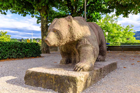 Bern, Switzerland - Aug 23, 2020: bear monument statue of Bern inside the Bear Pit, one of the most visited tourist destinations in Bern, Switzerland. The Bear Park overlooks Aare River. Editorial