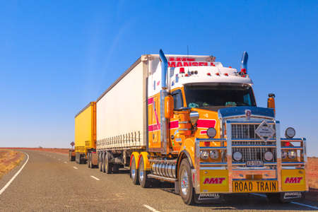 Northern Territory, Australia - August 27, 2019: Mansell group, road-train truck of Kenworth crossing the highways of the Northern Territory of Australian Outback. Editorial