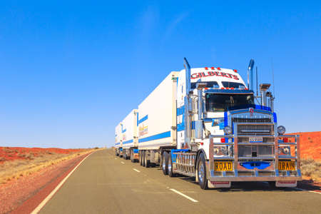 Northern Territory, Australia - August 27, 2019: Gilberts road-train truck of Kenworth crossing the highways of the Northern Territory of Australian Outback. Editorial
