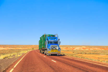Northern Territory, Australia - August 27, 2019: Ewings Mack road-train truck crossing the highways of the Northern Territory of Australian Outback.