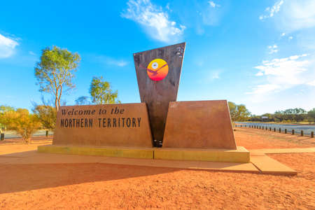 Northern Territory Outback, Australia - Aug 27, 2019: border sign between Australian states, Northern Territory and South Australia on A87 Stuart highway. Northern Territory side. Editorial