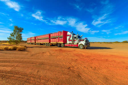 Marla, South Australia, Australia - August 29, 2019: Kenworth road-train truck of Hayson Haulage of Alice Springs. Parked in Marla town on A87 Stuart highway of Australian Outback.