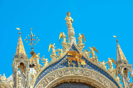 golden winged lion of San Marco Basilica in Venice. The main church of the city, located in Saint Mark square popular landmark of Venice city in Italy.