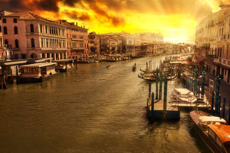 Sunset aerial view of Canal Grande from Rialto Bridge the main and biggest bridge of Venice city of Italy in Veneto region.