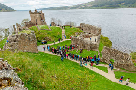 Loch Ness, Scotland, United Kingdom - May 24, 2015: tourists visiting Urquhart Castle beside Loch Ness lake. Visited for the legend of the Loch Ness monster: Nessie. Editöryel