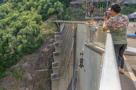 Verzasca, Switzerland - June 2021: people at Bungee jumping of Verzasca dam on Vogorno lake of Switzerland. location of James Bond movies in Ticino. Highest Bungee jumping of Europe. Editöryel