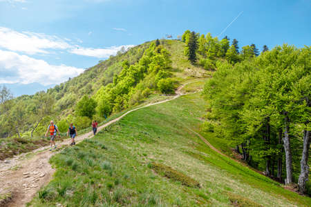 Verzasca, Switzerland - June 2021: people trekking down from top of Cardada-Cimetta mount in Switzerland. Swiss chairlift skyline of Locarno and Ascona on Lake Maggiore in Ticino. Editöryel