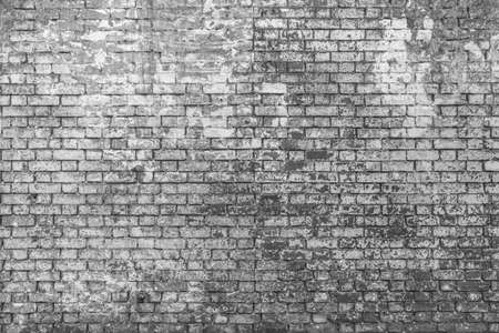 Old ruined bricks wall background in black and white. ruinous wall wreck texture for tapestry and wallpaper. Copy space on bricks wall. 3d background.
