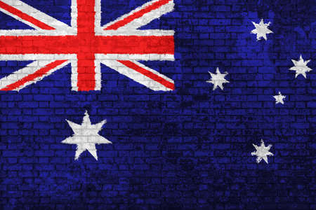 wall of bricks painted with the flag of Australia, red blue white colors. 3d background. Concept of social barriers of immigration, divisions, and political conflicts in Australia.