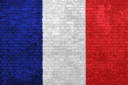 wall of bricks painted with the national flag of France. Blue, white red background. Concept of social barriers of immigration, divisions, and political conflicts in France.