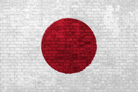 wall of bricks painted with the flag of Japan, red white colors. 3d background. Concept of social barriers of immigration, divisions, and political conflicts in Japan.