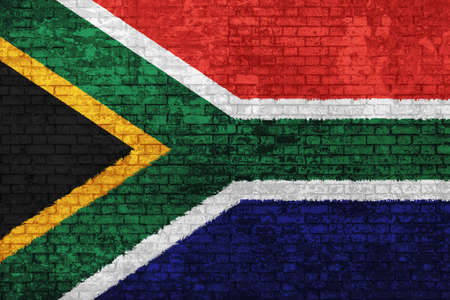 Wall of bricks painted with flag of South Africa, blue red black, white and yellow colors. 3d background. Concept of social barriers of immigration, divisions, and political conflicts in South Africa