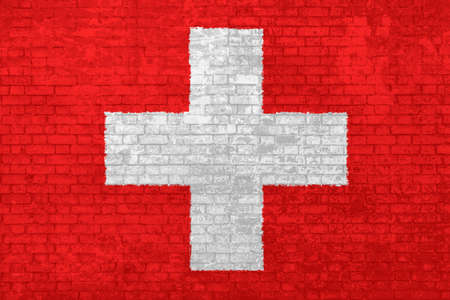 Wall of bricks painted with the national Switzerland flag in 3d background. Concept of social barriers of immigration, divisions, and political conflicts in Switzerland.