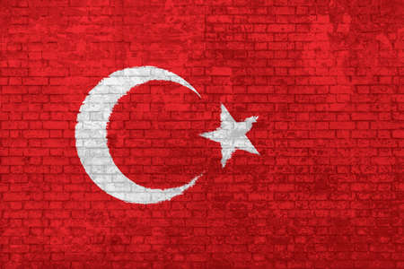 Wall of bricks painted with the national flat flag of Turkey. red color with star and half moon, 3d background. Concept of social barriers of immigration, divisions, and political conflicts in Turkey.