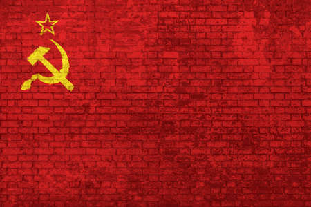 Wall of bricks painted with the Flag of the old Soviet Union, adopted from 12 November 1923 to 15 August 1980. Concept of social barriers, divisions, and political conflicts in 1980s.