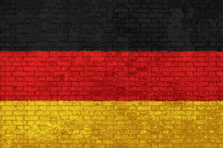 wall of bricks painted with the national flag of Germany. black, yellow and red. 3d background. Concept of social barriers of immigration, divisions, and political conflicts in Germany. Stok Fotoğraf