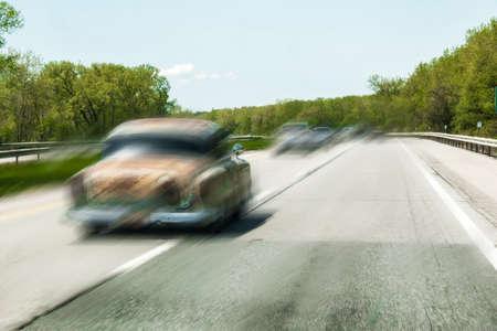 speeding car on highway Imagens