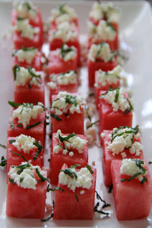 Watermelon squares with goat cheese