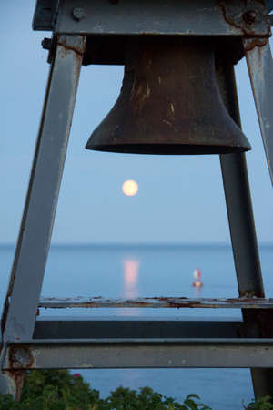 Moon through a light house bell in Southwest Harbor Maine Stock fotó