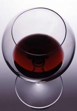 thinness: crystal glass with red wine and beautiful transparency Stock Photo