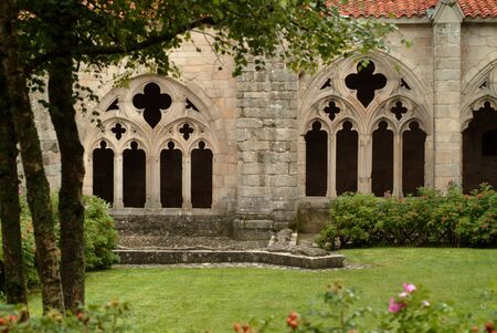 cloister: Sight of the courtyard and the arcs of a cloister Stock Photo