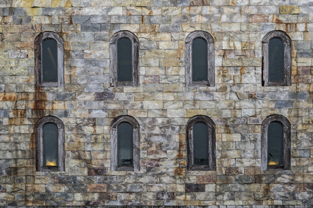 Old style glass windows on a castles wall