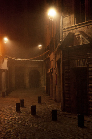 Foggy night in the medieval town of Pezenas in the south of France