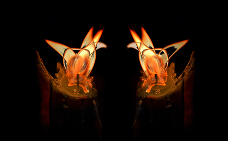 Close-up of a two burning candles mixed in a low-key image Stock Photo