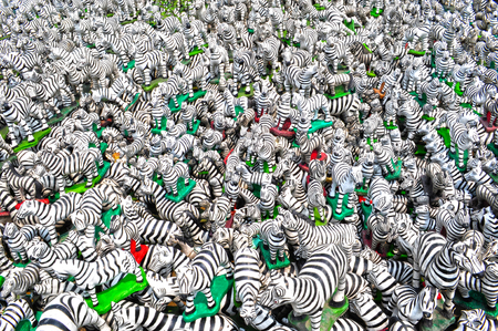Multitude of zebras statuettes at a shrine in central Thailand