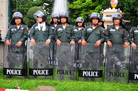 BangkokThailand - 11 24 2012: Riot police face protesters at Royal Plaza.