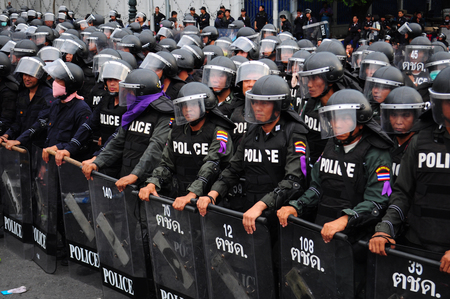 BangkokThailand - 11 24 2012: Riot police face protesters at Royal Plaza.