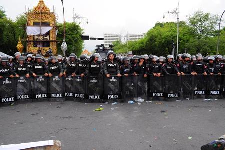 Bangkok/Thailand - 11 24 2012: Riot police face protesters at Royal Plaza.
