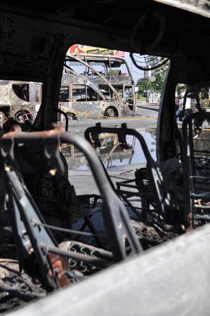 BangkokThailand - 12 02 2013: A bus and two vans got set on fire on Ramkhamhaeng road. Редакционное