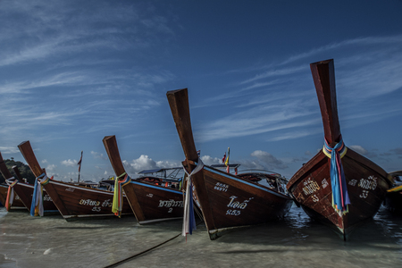 Traditional fishing boats on the beach on Koh Lipe in Southern Thailand. Editorial