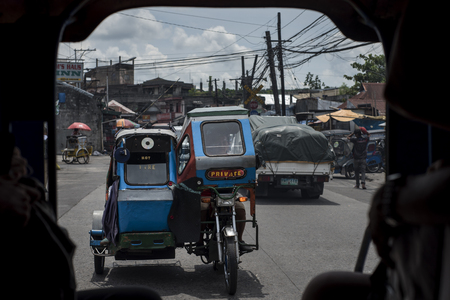 Tricycle seen from the inside of a jeepney in the Philippines.