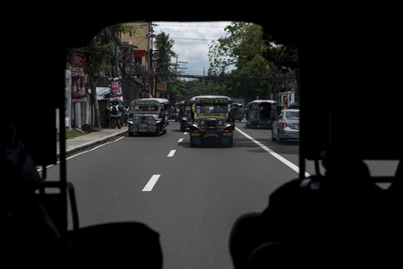 Jeepneys seen from the inside of another jeepney in Legazpi the Philippines.