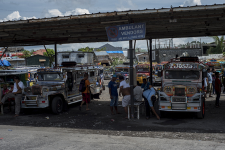 Jeepneys terminal in Legazpi in the Philippines. Stock Photo - 112496647